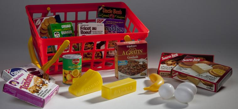 Toy grocery cart with food.