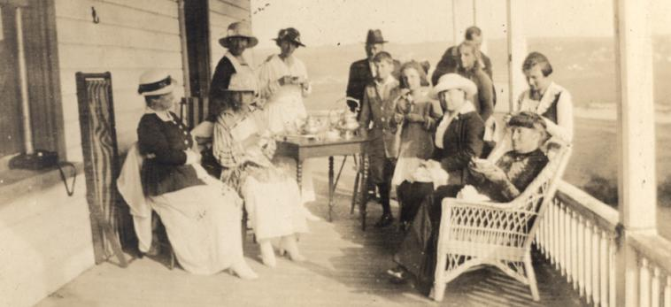 Photograph showing several people at teatime in a gallery.