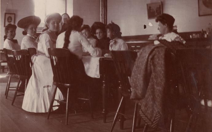 Photograph of people making sandwiches for a picnic.